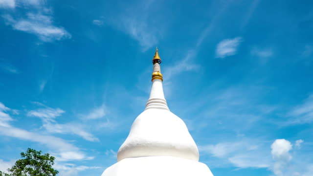 time lapse of white pagoda against blue sky in temple - pagoda stock videos and b-roll footage