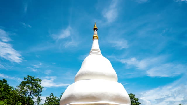 time lapse of white pagoda and blue sky in thai temple - pagoda stock videos and b-roll footage