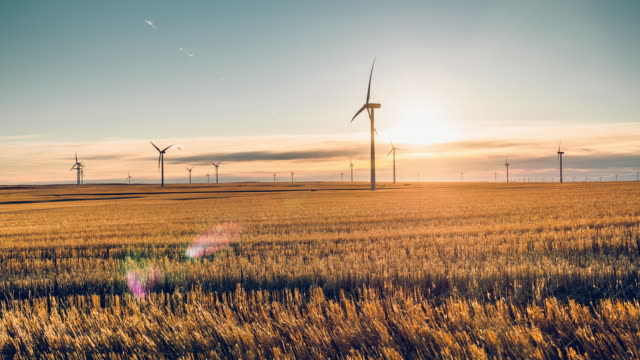 time lapse of windmill turbine - wind turbine stock videos & royalty-free footage