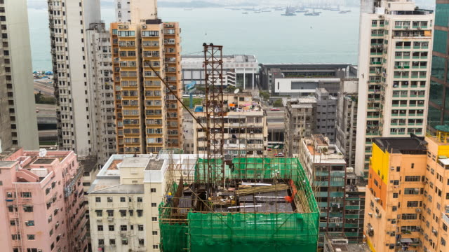 Time Lapse of workers building a skyscraper using bamboo scaffolding
