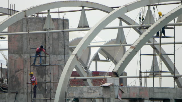 Time lapse of workers working on a metro station construction in India