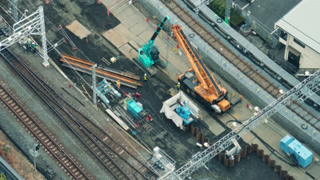 4k time lapse of working in construction site around rail transport area - railroad track stock videos & royalty-free footage