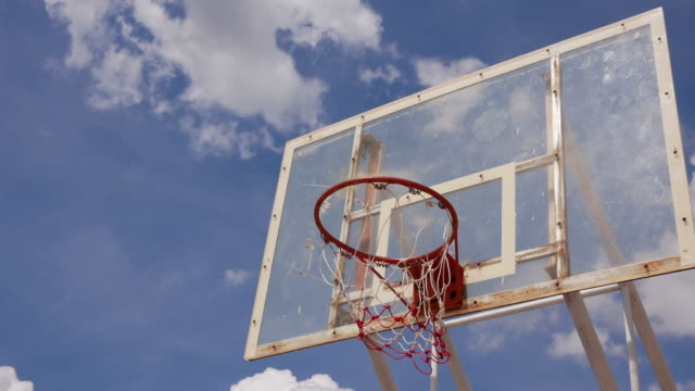 time lapse old basketball hoop with cloud motion - shooting baskets stock videos and b-roll footage