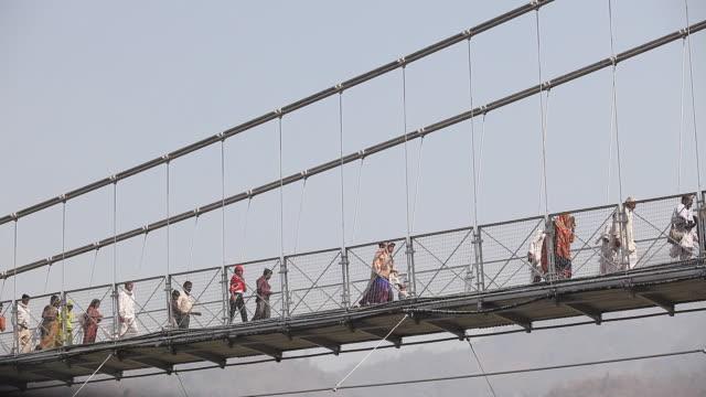 time lapse on lakshman jhula bridge in rishikesh - selimaksan stock videos & royalty-free footage