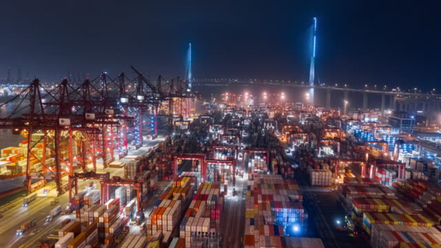 4k time lapse or hyper lapse : aerial view container cargo warehouse at terminal commercial port at night for business logistics, import export, shipping or transportation - freight elevator stock videos & royalty-free footage