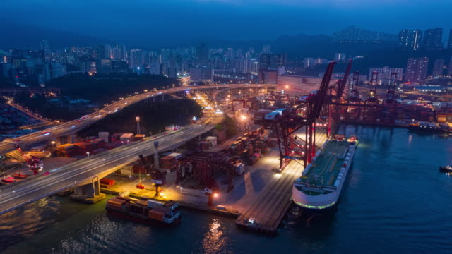 4k time lapse or hyper lapse : aerial view container cargo warehouse at terminal commercial port at dusk for business logistics, import export, shipping or transportation. - freight elevator stock videos & royalty-free footage