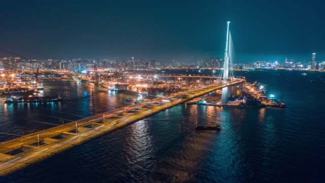 4k time lapse or hyper lapse : aerial view hong kong cityscape and terminal commercial port at night for business logistics, import export, shipping or transportation - unloading stock videos & royalty-free footage