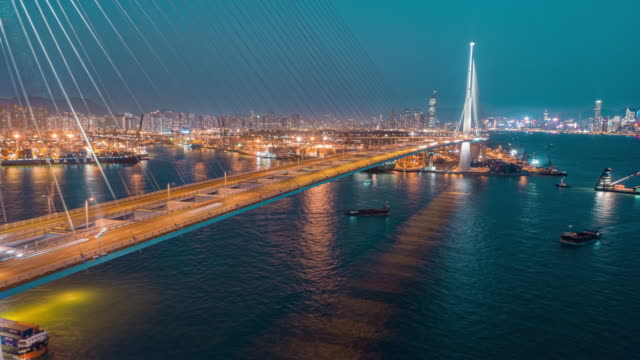4k time lapse or hyper lapse : aerial view stonecutters bridge and container cargo warehouse at terminal commercial port at night for business logistics, import export, shipping or transportation - freight elevator stock videos & royalty-free footage