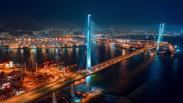 4k time lapse or hyper lapse : aerial view terminal commercial port and container cargo ship with cityscape at night for business logistics, import export, shipping or transportation. - ship's bridge stock videos & royalty-free footage