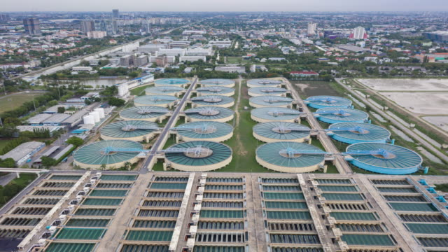 4k time lapse or hyper lapse : aerial view water treatment plant for environment conservation. - purified water stock videos & royalty-free footage