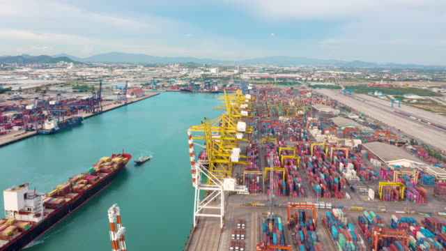 4k time lapse or hyper lapse : container cargo ship at terminal commercial port for business logistics, import export, shipping or transportation. - trasporto merci via terra video stock e b–roll