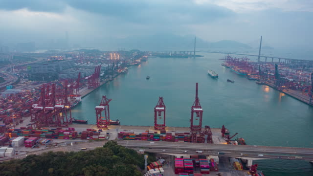 4k time lapse or hyper lapse : container cargo warehouse at terminal commercial port at dusk for business logistics, import export, shipping or transportation - freight elevator stock videos & royalty-free footage