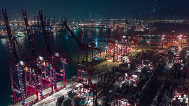 4k time lapse or hyper lapse : terminal commercial port or container warehouse at night for business logistics, import export, shipping or transportation - freight elevator stock videos & royalty-free footage