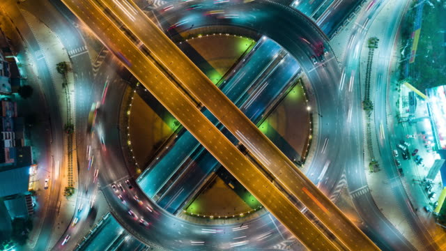 4k time lapse or hyper lapse zoom out : aerial view network or intersection of highway road for transportation or distribution concept background. - automobile industry video stock e b–roll