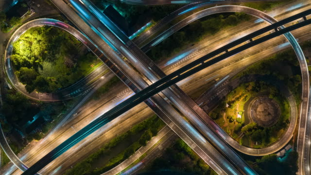 4k time lapse or hyper lapse zoom out : aerial view network or intersection of highway road for transportation or distribution concept background. - esposizione lunga video stock e b–roll