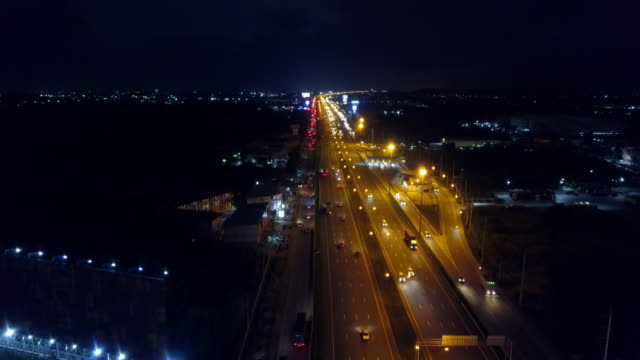 4k time lapse or hyper lapse zoom out : aerial view network or intersection of highway road for transportation or distribution concept background. - zoom out stock videos & royalty-free footage