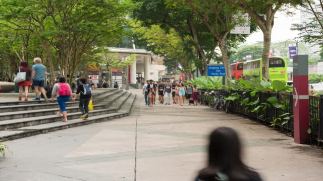 4k time lapse : orchard road shopping mall and metro entrance - orchard stock videos & royalty-free footage