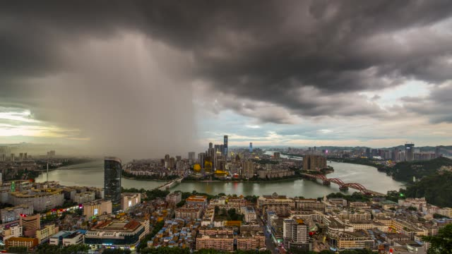 time lapse over a day as rain falls across the city. a view of the skyline on august 3, 2020 in liuzhou, guangxi zhuang autonomous region of china. - guangxi zhuang autonomous region china stock videos & royalty-free footage