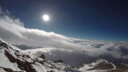 Time lapse over the cloudy sky on Aconcagua