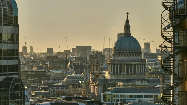 a time lapse over the rooftops of london looking west towards the dome of st paul's cathedral - st. paul's cathedral london stock videos & royalty-free footage