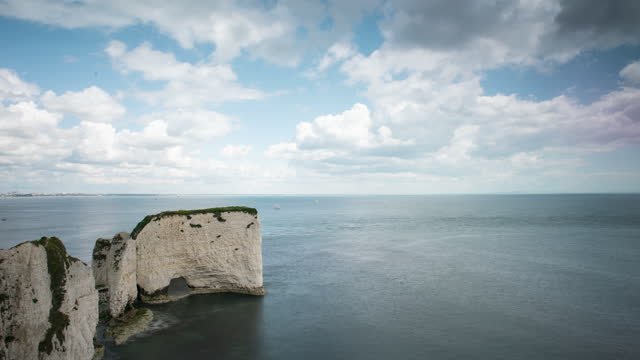 time lapse over white rock formation - rock face stock videos & royalty-free footage