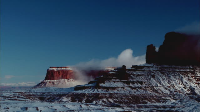 time lapse pan clouds rolling over monument valley on the navajo reservation / southwest usa - monument valley stock videos and b-roll footage
