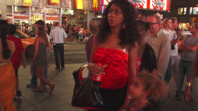 a time lapse pan of time square at night.  people speed by - western script stock videos & royalty-free footage