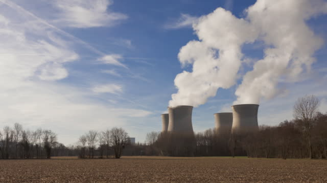 time lapse pan shot of nuclear plant - nuclear energy stock videos & royalty-free footage
