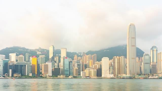 4k time lapse : panorama landmark skyscraper buildings at victoria harbor in hong kong city - victoria hong kong stock videos & royalty-free footage