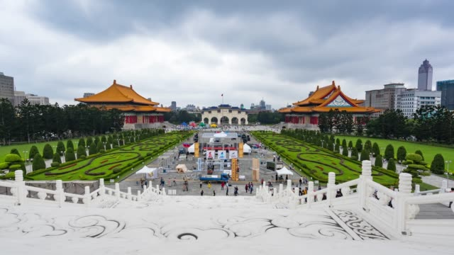 4k time lapse : panoramic  cityscape famous place chiang kai-shek memorial hall in zhongzheng district in city taipei, taiwan - taiwan stock videos & royalty-free footage