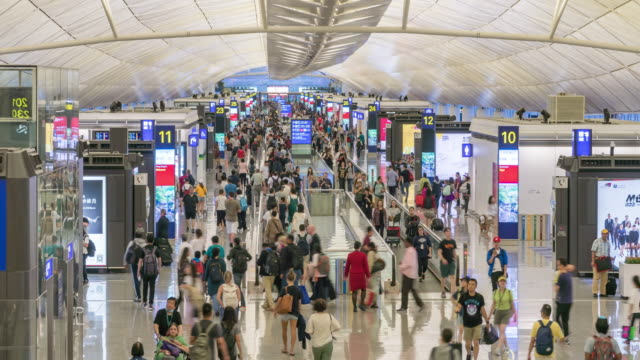 4k time lapse : passenger walking in terminal airport - crowded airport stock videos & royalty-free footage