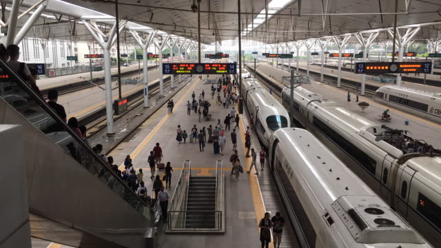 time lapse: passengers and high speed train on platform - railway station stock videos and b-roll footage