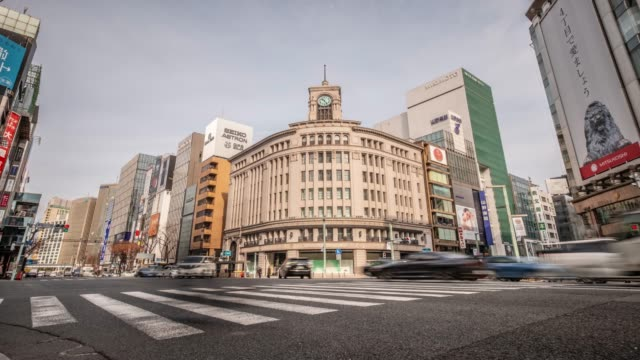 4k time lapse - pedestrian crossing intersection in front of old building center of ginza - tokyo japan - ginza stock videos & royalty-free footage