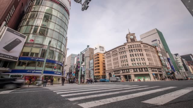 4k time lapse - pedestrian crossing zebra crossing with traffic light and car transportation - ginza tokyo japan - ginza stock videos & royalty-free footage