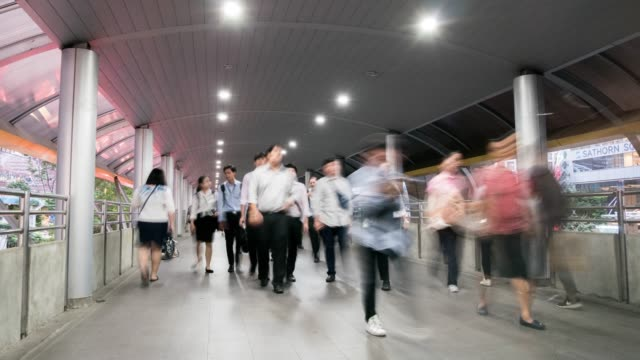time lapse: pedestrian people walking on indoor walkway