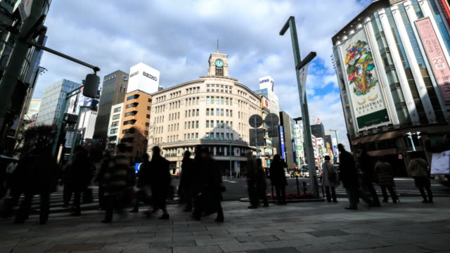 4k time lapse : pedestrians cross at ginza crossing - ginza stock videos & royalty-free footage
