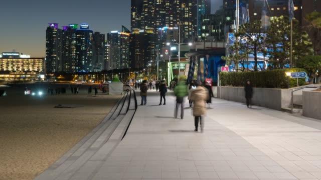 4k time lapse : pedestrians tourist walking at haedong beach ,busan city south korea - korea stock videos & royalty-free footage