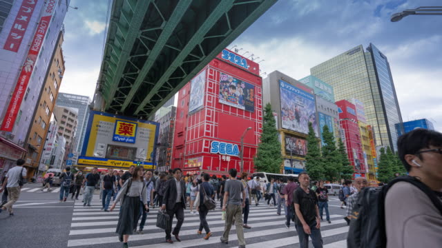 4k time lapse pedestrians walking at akihabara district, tokyo, japan. - akihabara stock videos and b-roll footage