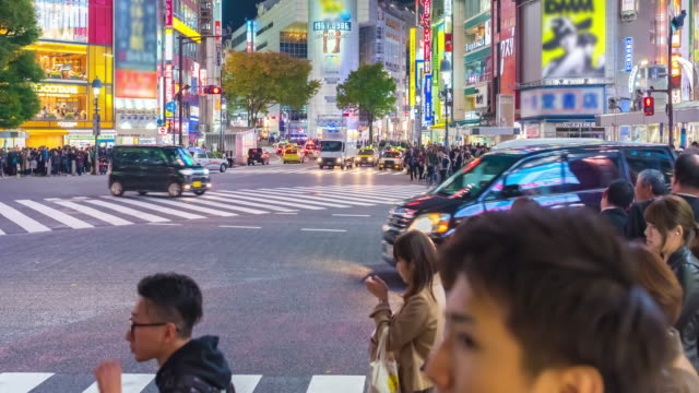 4K Time Lapse : People and cars cross the famous intersection in Shibuya, Tokyo, Japan