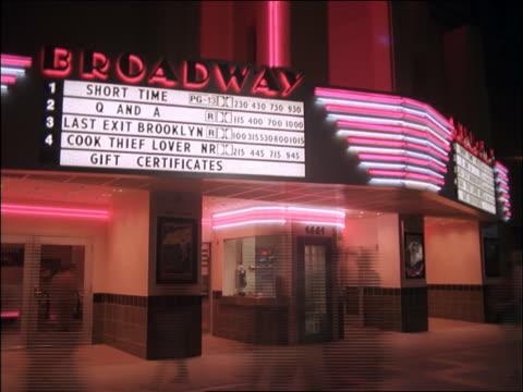 vídeos y material grabado en eventos de stock de time lapse people at movie theatre - cartel de teatro