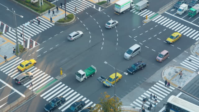4k time lapse :  people crowd shopping street aerial view pedestrians crossing in tokyo japan - incontinence stock videos and b-roll footage