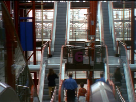 time lapse people going up + down escalators by mirrors in Zeilgalerie shopping mall / Frankfurt, Germany