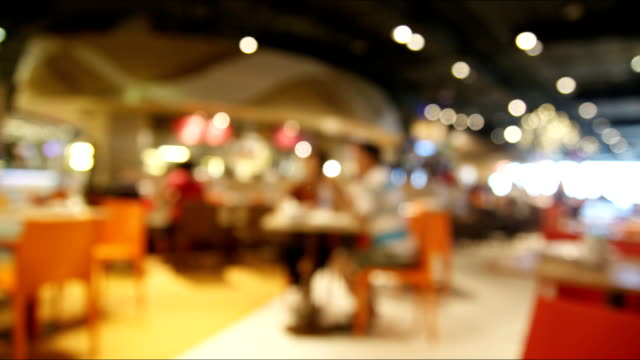 Time lapse people in restaurant blur background with bokeh