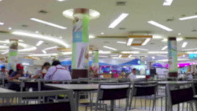 time lapse: people order sit and eat food at street market food court - food court stock videos and b-roll footage