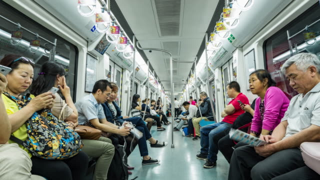 time lapse- people travelling by subway train, beijing, china (ws la) - subway train stock videos & royalty-free footage