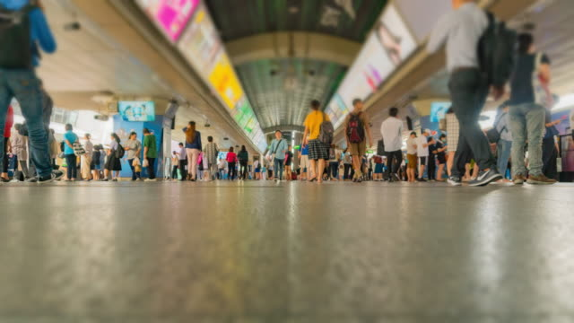 4k time lapse : people waiting in line at train station - people in a line stock videos & royalty-free footage