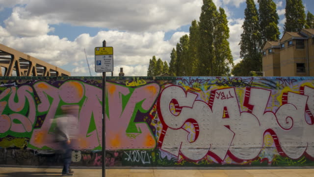 time lapse people walk past graffiti on brick lane, london - commuter stock videos & royalty-free footage