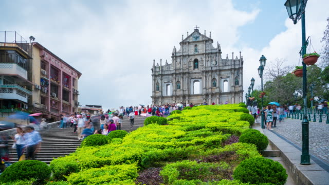 4k time lapse : people walk up the stairs that lead to saint paul's church on a very sunny day - macao flag stock videos and b-roll footage