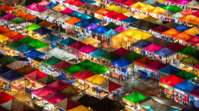 4k time lapse: people walking in popular night market at bangkok, thailand - multi coloured stock videos & royalty-free footage