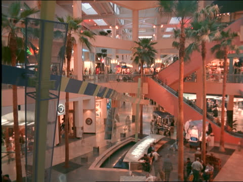time lapse people walking thru los angeles shopping mall + on escalator - shopping centre stock videos & royalty-free footage